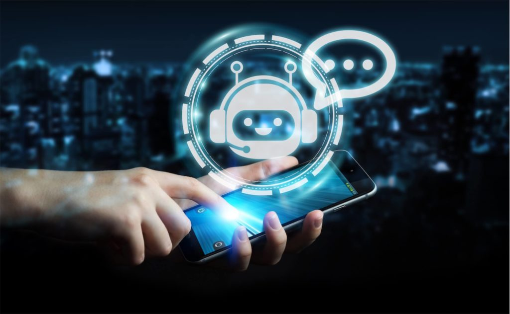 A hand and smartphone against a graphic of a chatbot, a rising trend in digital marketing any content marketing agency in Singapore would be aware of