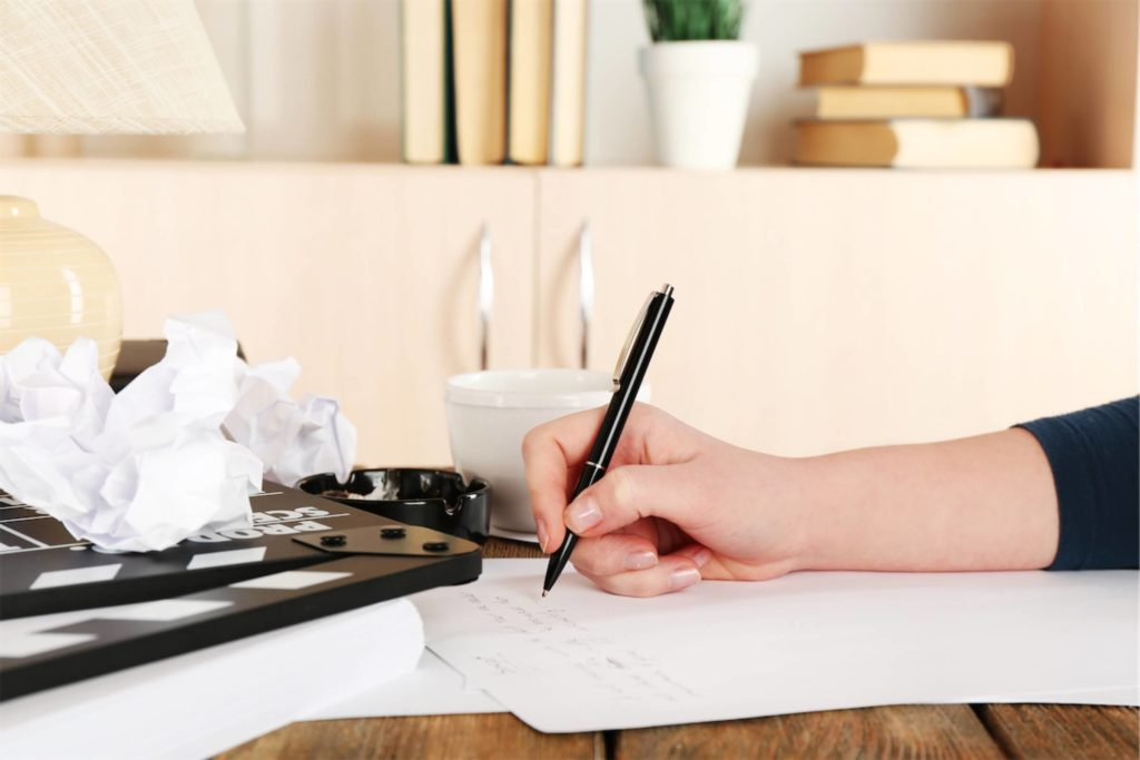 Drafting a long-form article with a pen and paper