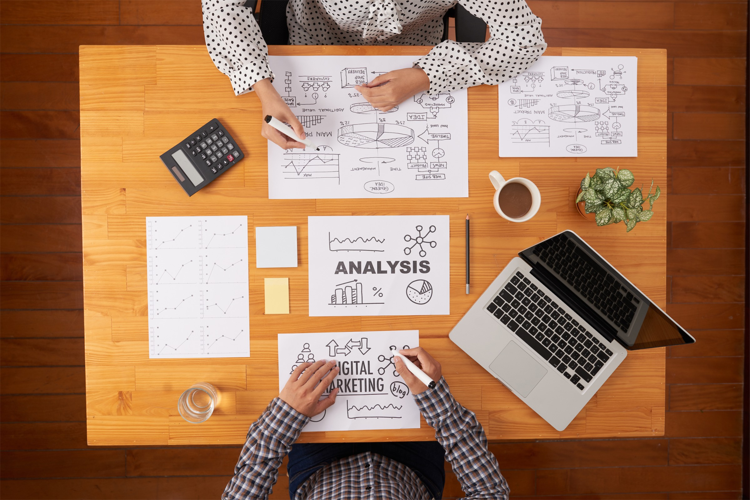 2 individuals crafting a content marketing strategy at an agency
