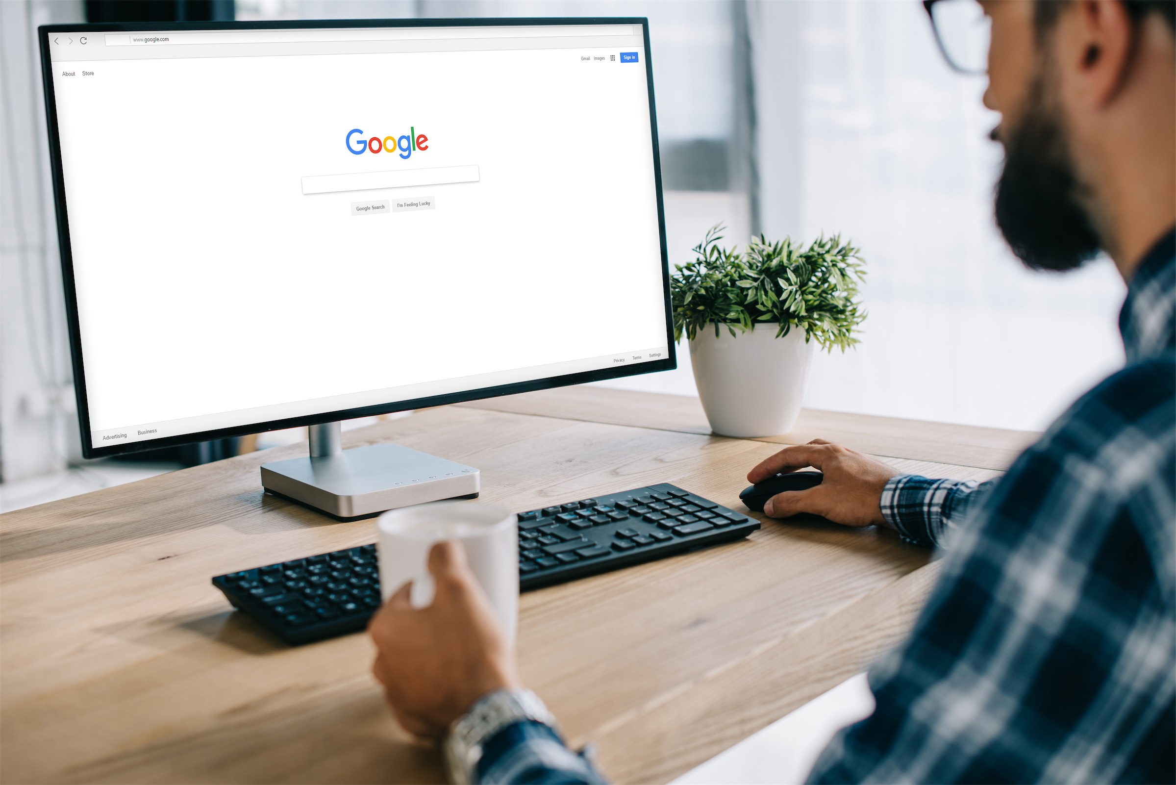 A man doing a Google search to get started on creating SEO content