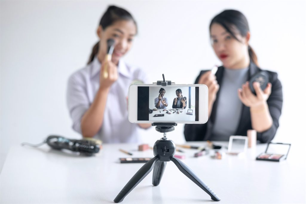 Two women live streaming a make-up tutorial