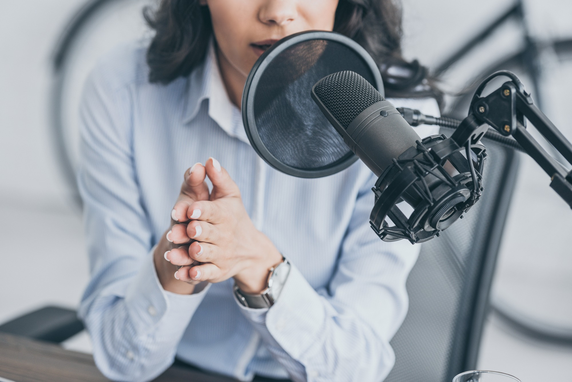 A woman recording a podcast for content marketing