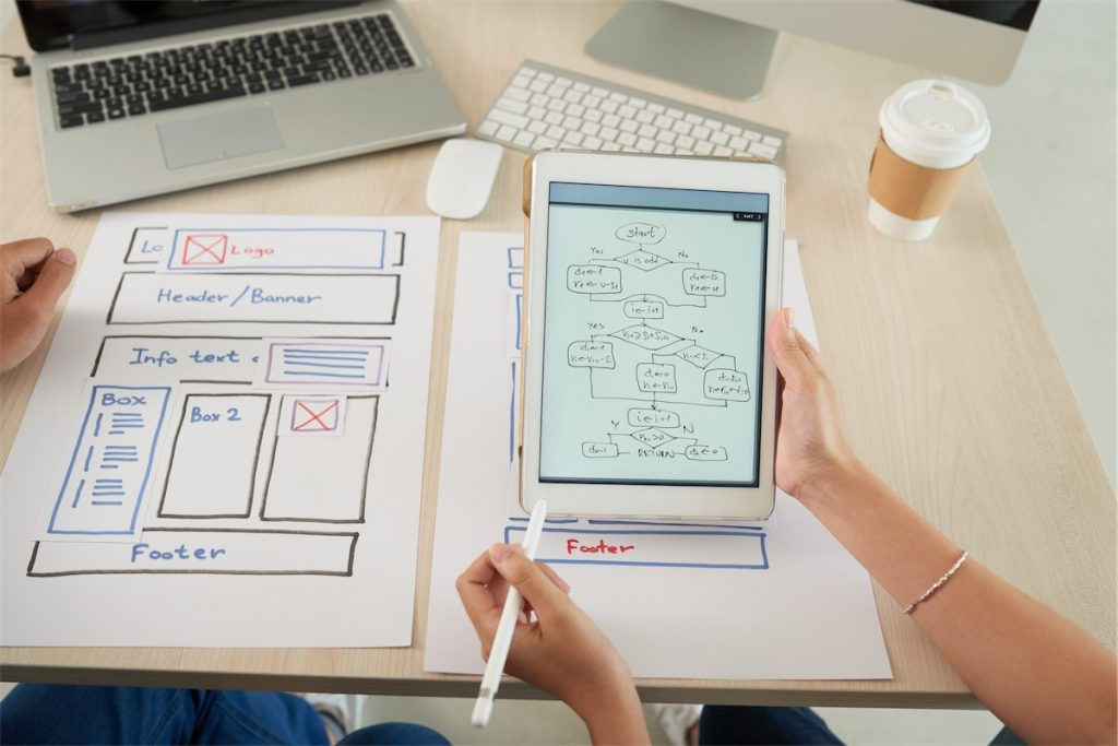 An individual doing website design, which is essential in digital marketing