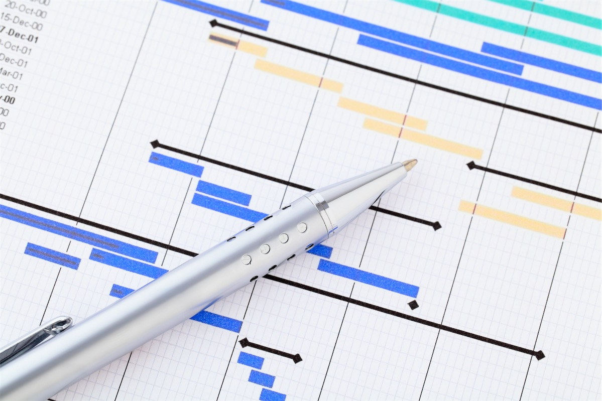 A pen on top of a content calendar