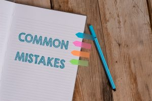 "The word ""common mistakes"" written on a notebook"