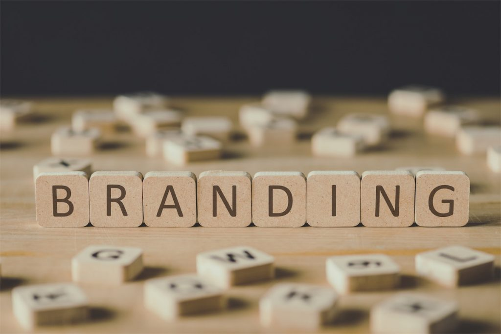 Wooden blocks spelling branding, a key component of content marketing